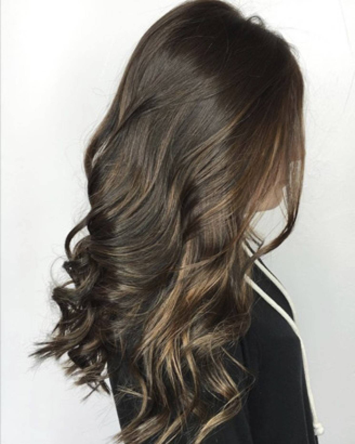 Shiny curled long brunette brown hair